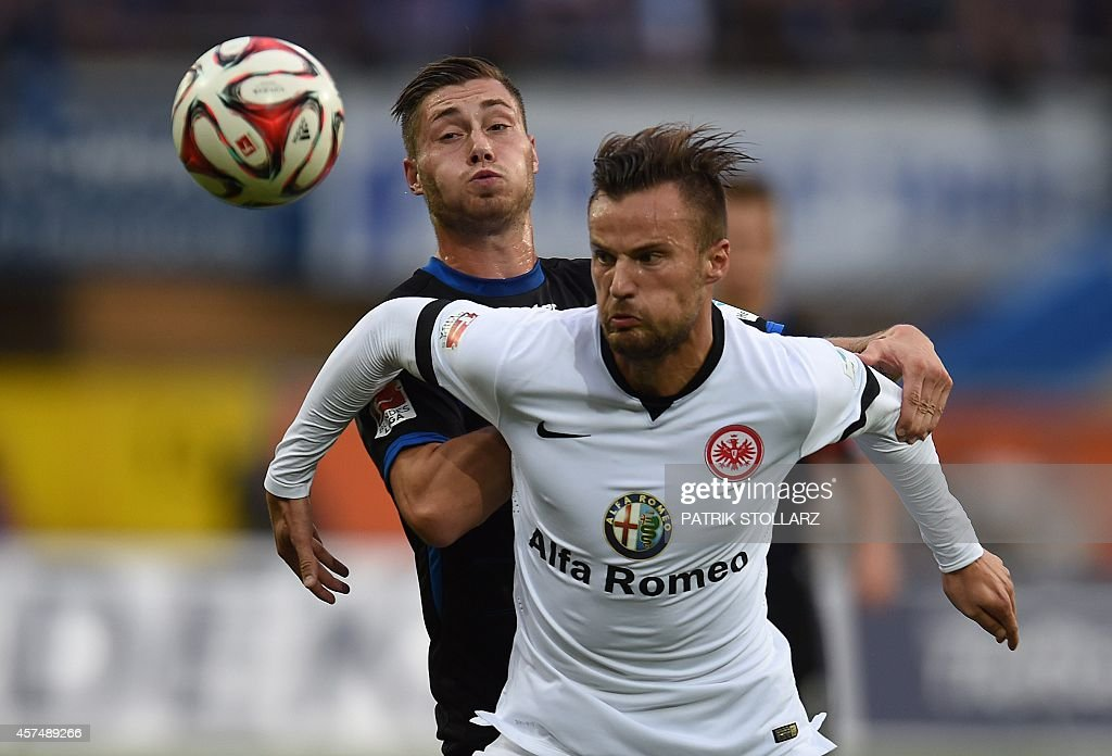 Frankfurt's Swiss forward Haris Seferovic and Paderborn's defender Michalel Heinloth vie for the ball during the German First division Bundesliga...