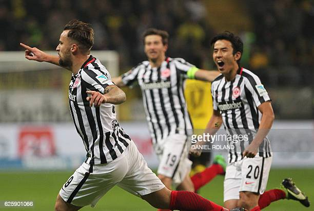 Frankfurt's Swiss forward Haris Seferovic celebrates with teammates after scoring the 21 during the German first division Bundesliga football match...