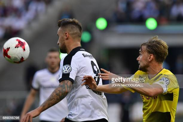 Frankfurt's Swiss striker Haris Seferovic and Dortmund's defender Marcel Schmelzer vie for the ball during the German Cup final football match...