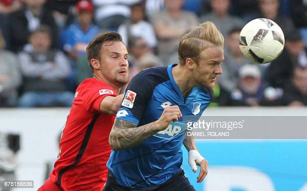 Frankfurt's Swiss striker Haris Seferovic and Hoffenheim's midfielder Kevin Vogt vie for the ball during the German first division Bundesliga...