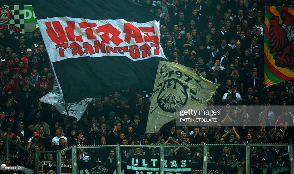 Frankfurt´s Ultra fans wave flags during the German first division Bundesliga football match FC Schalke 04 vs Eintracht Frankfurt in the German city of Gelsenkirchen on November 24, 2012. AFP PHOTO / PATRIK STOLLARZ