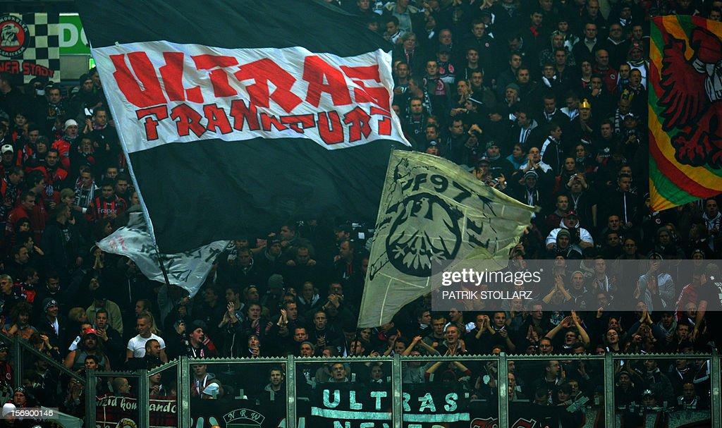 Frankfurt´s Ultra fans wave flags during the German first division Bundesliga football match FC Schalke 04 vs Eintracht Frankfurt in the German city of Gelsenkirchen on November 24, 2012.