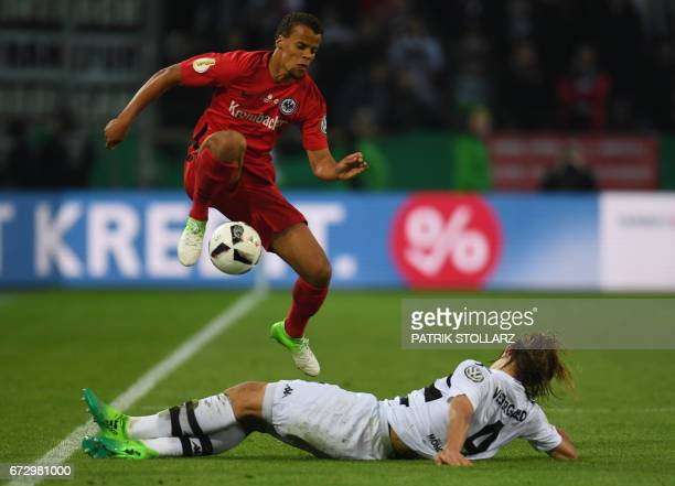Frankfurt's US defender Timothy Chandler and Moenchengladbach's midfielder Marvin Schulz vie for the ball during the German Cup DFB Pokal semifinal...