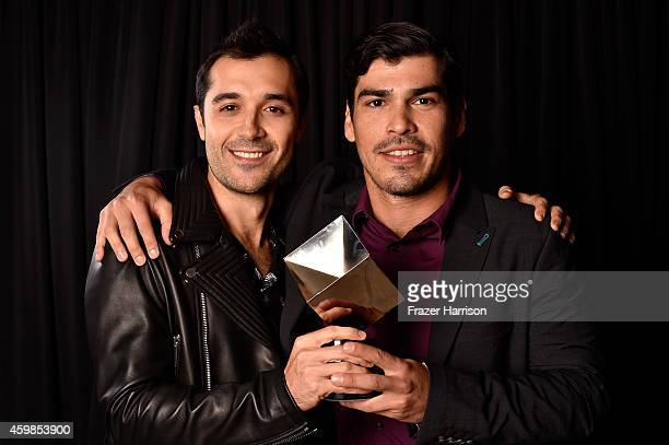 Frankie Alvarez and Raul Castillo pose for a portrait with the award for Best New Television Series for 'Looking' at Logo TV's 2014 NewNowNext Awards...