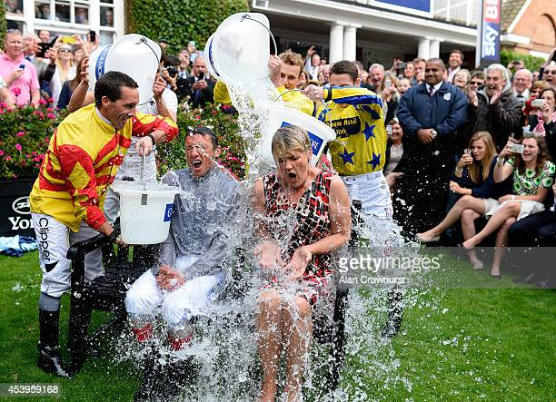 Frankie Dettori and Clare Balding take part in the 'Ice Bucket Challenge' at York racecourse on August 22 2014 in York England