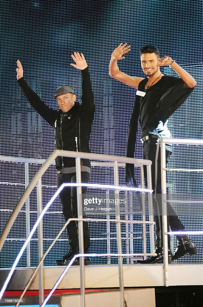 Frankie Dettori and Rylan Clark enter the Celebrity Big Brother House at Elstree Studios on January 3, 2013 in Borehamwood, England.