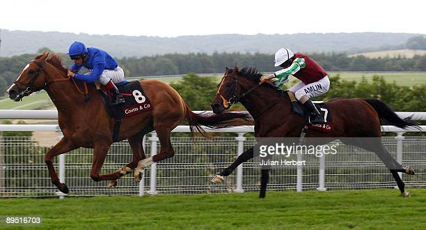 Frankie Dettori and Schiaparelli lead the Ryan Moore ridden Mourilyan home to land The Coutts Goodwood Cup Race run at Goodwood on July 30 2009 in...