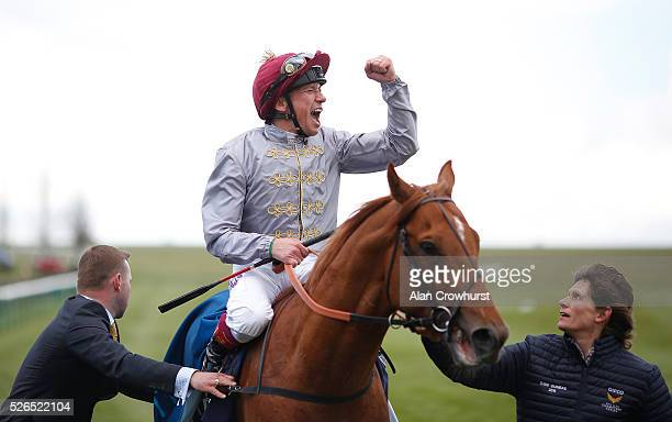 Frankie Dettori celebrates after riding Galileo Gold to win The Qipco 2000 Guineas Stakes at Newmarket racecourse on April 30 2016 in Newmarket...