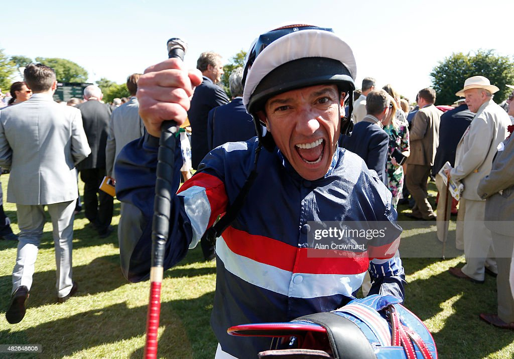 Frankie Dettori celebrates after riding Magical Memory to win The Qatar Stewards' Cup at Goodwood racecourse on August 01, 2015 in Chichester, England.