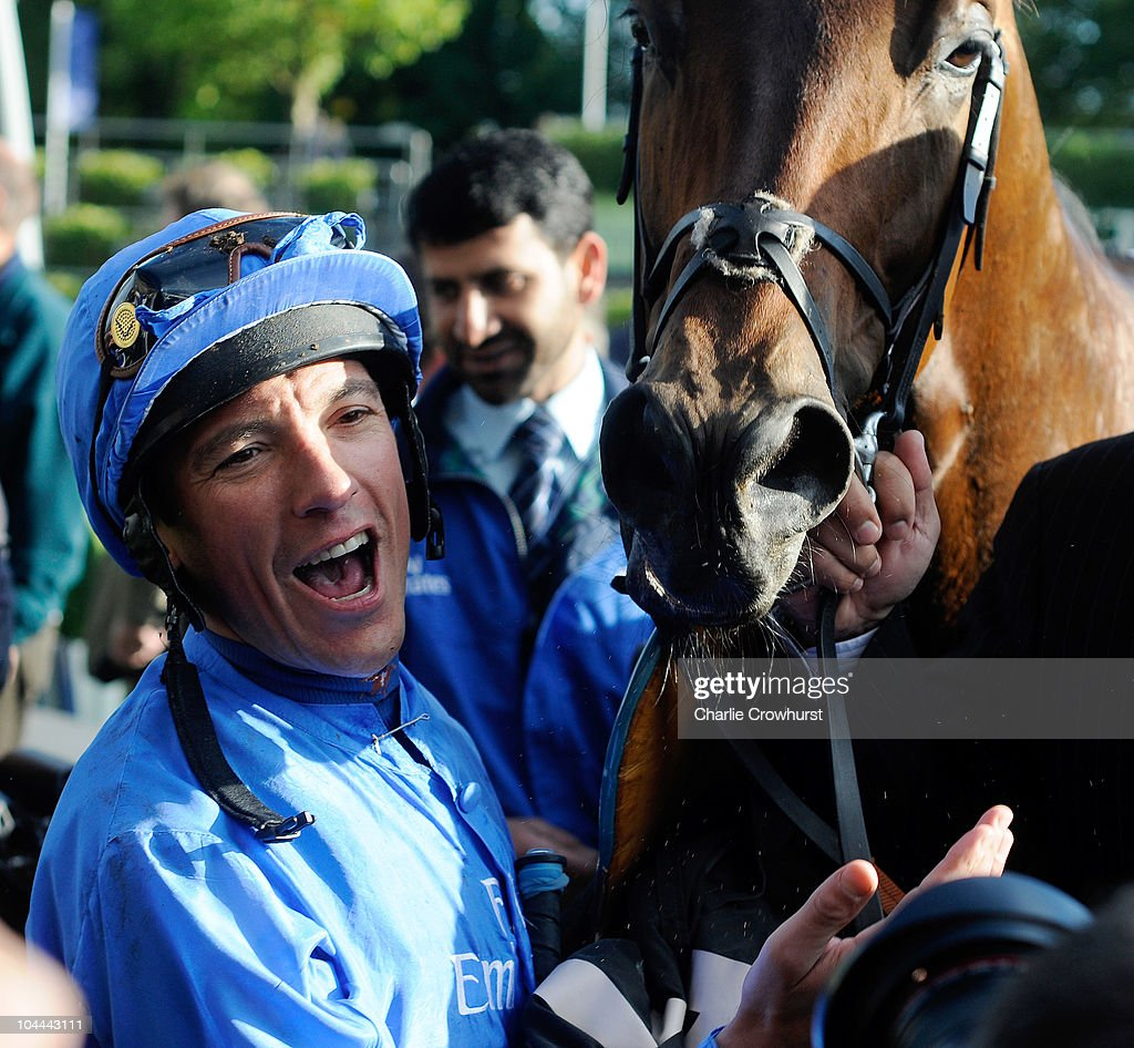 <a gi-track='captionPersonalityLinkClicked' href=/galleries/search?phrase=Frankie+Dettori&family=editorial&specificpeople=167142 ng-click='$event.stopPropagation()'>Frankie Dettori</a> celebrates after riding Poet's Voice to victory in the Queen Elizabeth II Stakes at Ascot racecourse on September 25, 2010 in Ascot, England