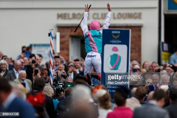 Frankie Dettori celebrates as he leaps from his mount after riding Enable to win The Darley Yorkshire Oaks at York racecourse on August 24 2017 in...