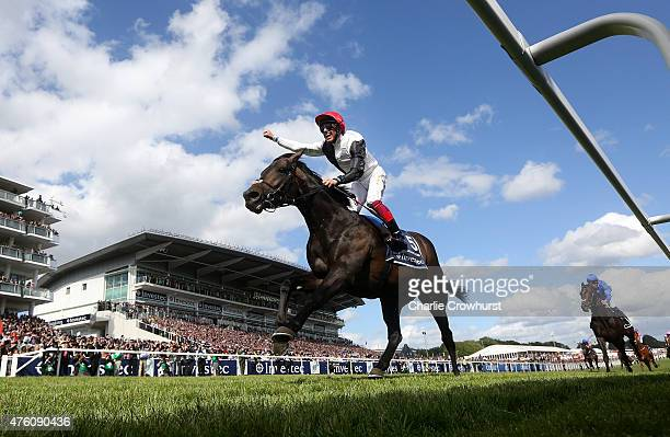 Frankie Dettori celebrates as he rides Golden Horn to win The Investec Derby at Epsom racecourse on June 06 2015 in Epsom England