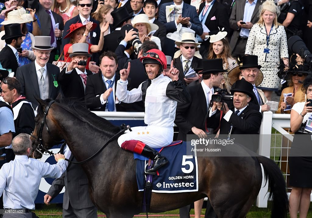 Frankie Dettori celebrates on his horse Golden Horn after winning the Investec Derby at Epsom racecourse on June 06 2015 in Epsom England