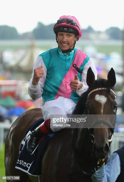 Frankie Dettori celebrates riding Enable to victory in The Investec Oaks during the Investec Ladies Day at Epsom Downs Racecourse on June 2 2017 in...