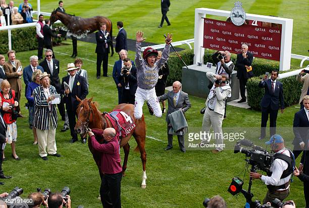 Frankie Dettori celebrates riding Galileo Gold to win The Qatar Vintage Stakes at Goodwood racecourse on July 28 2015 in Chichester England