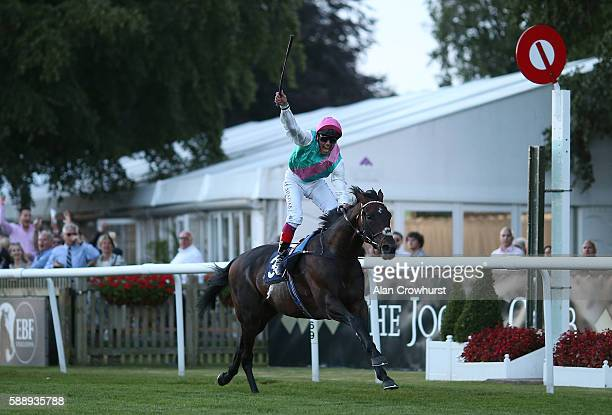Frankie Dettori celebrates riding his 3000th winner on Predilection in The James Hardie Cladding @UPlastics Handicap Stakes at Newmarket Racecourse...