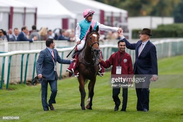 Frankie Dettori celebrates with John Gosden after riding Enable to win The Prix de l'Arc de Triomphe during Prix de l'Arc de Triomphe meeting at...