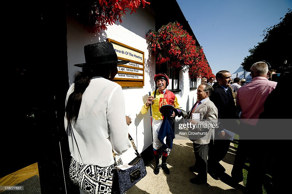<a gi-track='captionPersonalityLinkClicked' href=/galleries/search?phrase=Frankie+Dettori&family=editorial&specificpeople=167142 ng-click='$event.stopPropagation()'>Frankie Dettori</a> greets friends at Newmarket racecourse on July 11, 2013 in Newmarket, England.