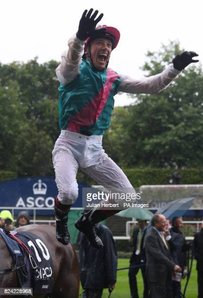 Frankie Dettori jumps from Enable after winning The King George VI Queen Elizabeth Stakes run during day two of King George VI Weekend at Ascot...