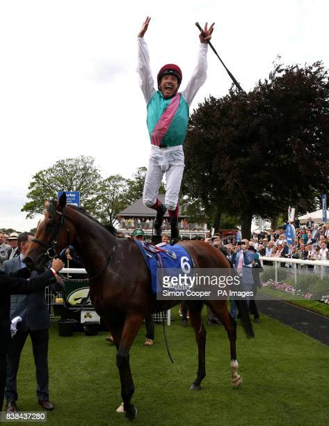 Frankie Dettori leaps from Enable after winning The Darley Yorkshire Oaks during Darley Yorkshire Oaks and Ladies Day of the Yorkshire Ebor Festival...
