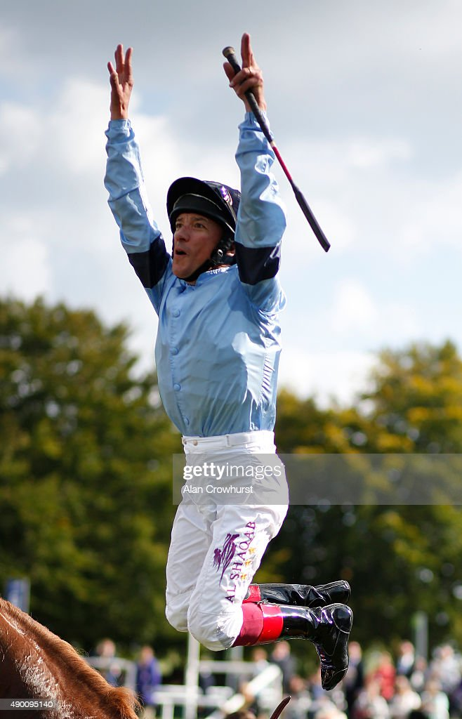 Frankie Dettori leaps from Foundation after riding him to victory in The Juddmonte Royal Lodge Stakes at Newmarket racecourse on September 26 2015 in...
