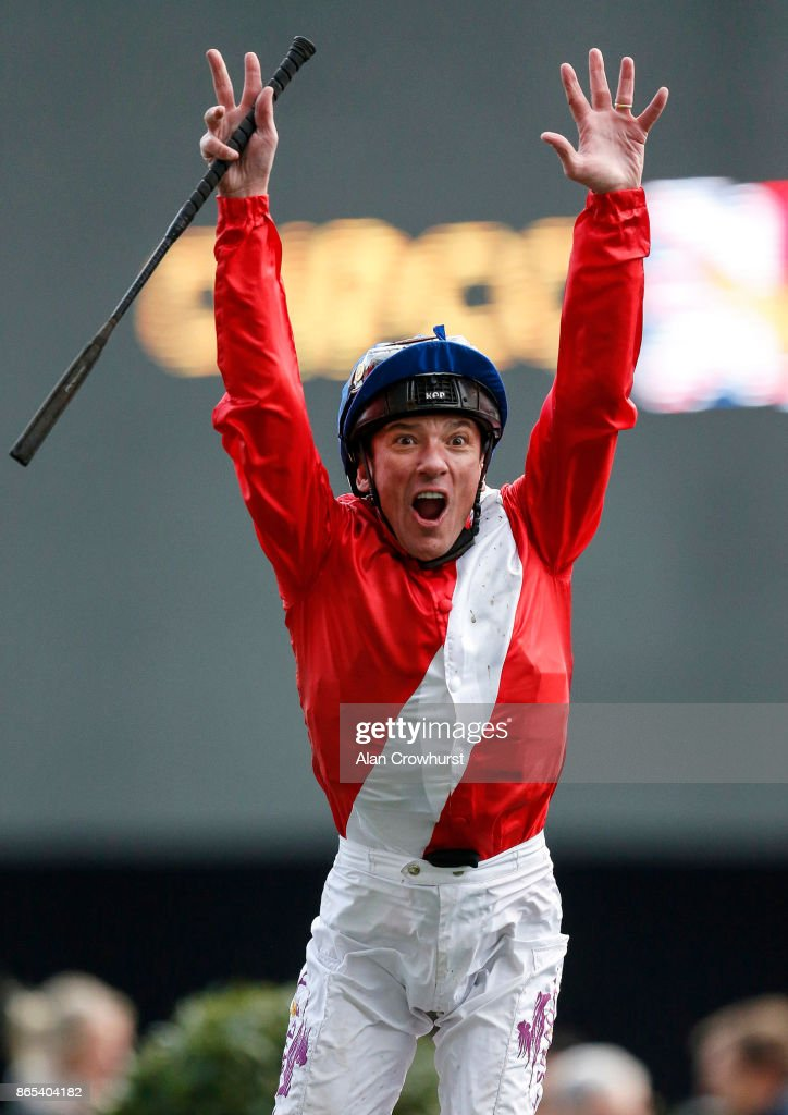 Frankie Dettori leaps from Persuasive after winning The Queen Elizabeth II Stakes at Ascot racecourse on QIPCO British Champions Day on October 21, 2017 in Ascot, United Kingdom.