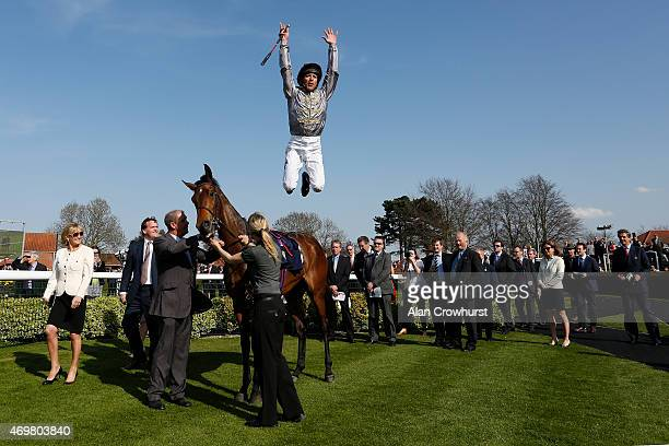 Frankie Dettori leaps in the winners enclosure after riding to win Osaila The Lanwades Stud Nell Gwyn Stakes at Newmarket racecourse on April 15 2015...