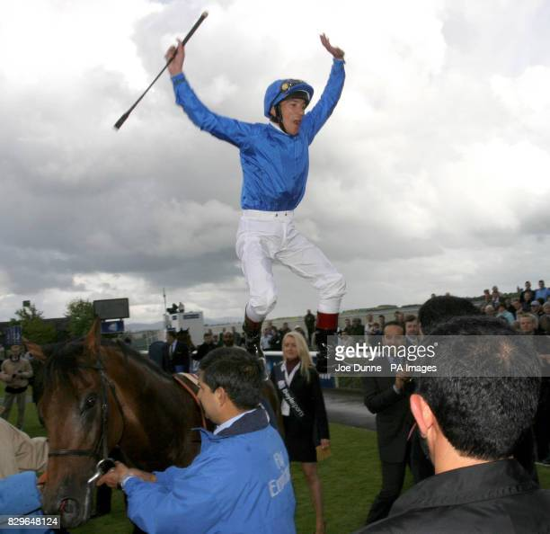 Frankie Dettori makes a flying dismount after winning the Boyle Sports 2000 Irish Guineas on Dubawi