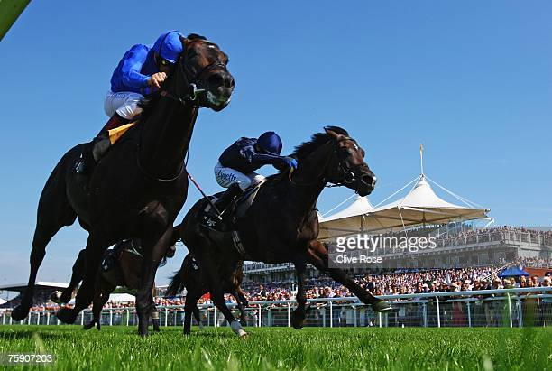Frankie Dettori on Ramonti leads Jamie Spencer on Excellent Art to win The BGC Sussex stakes run at Goodwood Racecourse on August 1 in Goodwood...