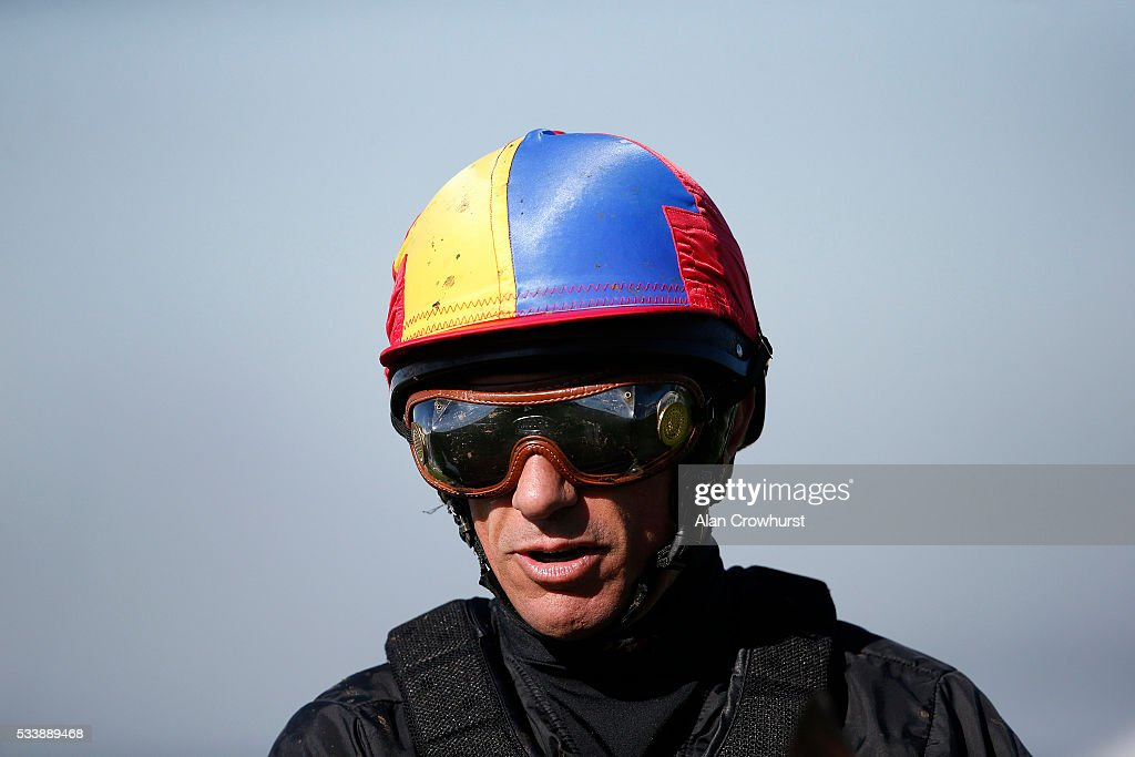 <a gi-track='captionPersonalityLinkClicked' href=/galleries/search?phrase=Frankie+Dettori&family=editorial&specificpeople=167142 ng-click='$event.stopPropagation()'>Frankie Dettori</a> poses during the 'Breakfast with the Stars' morning at Epsom Racecourse on May 24, 2016 in Epsom, England.