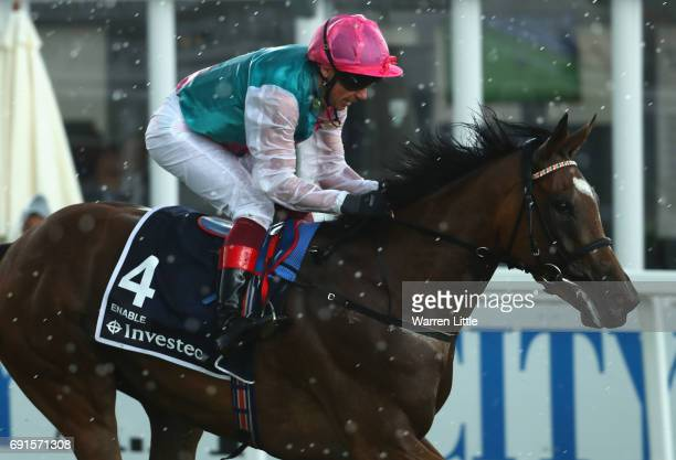 Frankie Dettori rides Enable to victory in The Investec Oaks during the Investec Ladies Day at Epsom Downs Racecourse on June 2 2017 in Epsom England