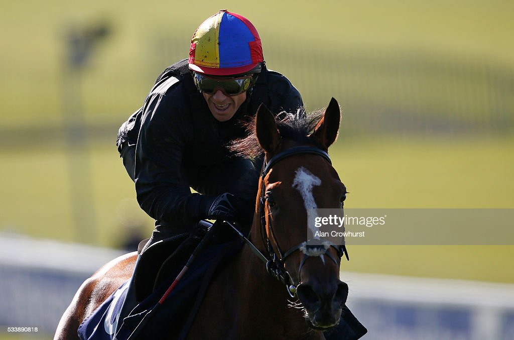 <a gi-track='captionPersonalityLinkClicked' href=/galleries/search?phrase=Frankie+Dettori&family=editorial&specificpeople=167142 ng-click='$event.stopPropagation()'>Frankie Dettori</a> riding Architecture have a racecourse gallop during the 'Breakfast with the Stars' morning at Epsom Racecourse on May 24, 2016 in Epsom, England.