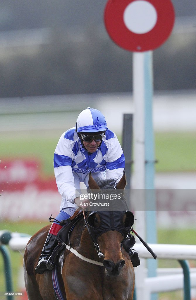 <a gi-track='captionPersonalityLinkClicked' href=/galleries/search?phrase=Frankie+Dettori&family=editorial&specificpeople=167142 ng-click='$event.stopPropagation()'>Frankie Dettori</a> riding Eco Warrior win The coral.co.uk Median Auction Maiden Stakes on his comeback ride after breaking his ankle at Lingfield racecourse on January 22, 2014 in Lingfield, England.