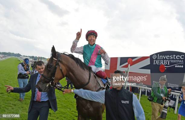 Frankie Dettori riding Enable celebrates winning the Investec Oaks race during Ladies Day of the 2017 Investec Derby Festival at The Jockey Club's...