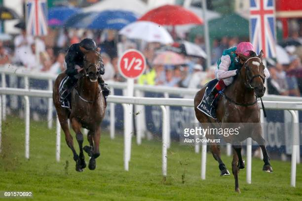 Frankie Dettori riding Enable win The Investec Oaks from Rhododendron on Ladies Day at Epsom Racecourse on June 2 2017 in Epsom England