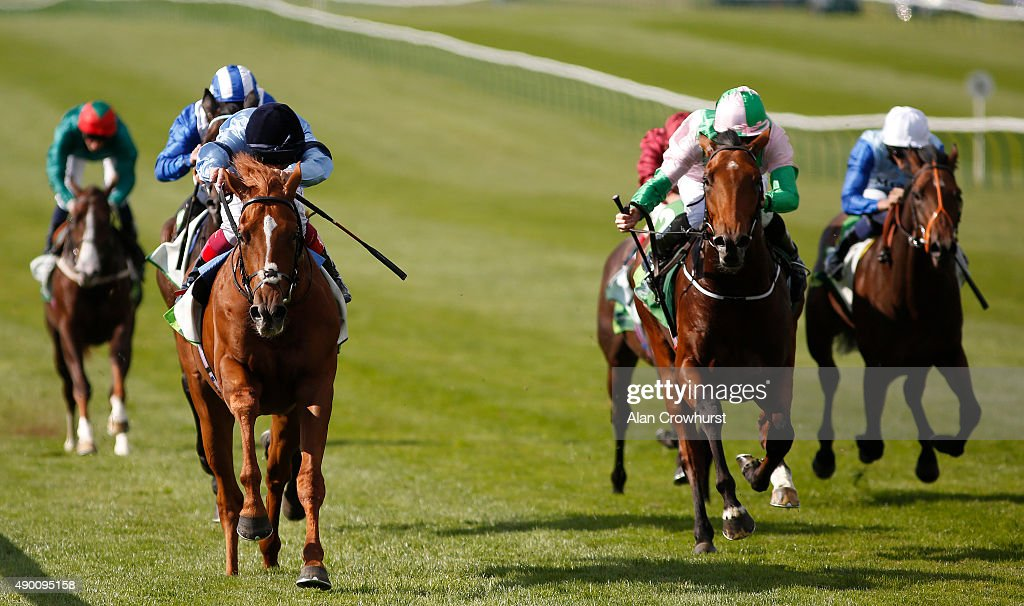 Frankie Dettori riding Foundation win The Juddmonte Royal Lodge Stakes at Newmarket racecourse on September 26 2015 in Newmarket England