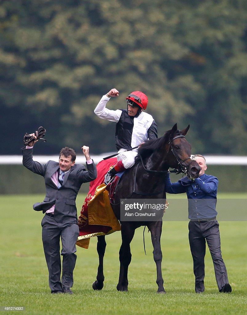 Frankie Dettori riding Golden Horn celebrate winning The Qatar Prix De L'Arc De Triomphe at Longchamp racecourse on October 04 2015 in Paris France