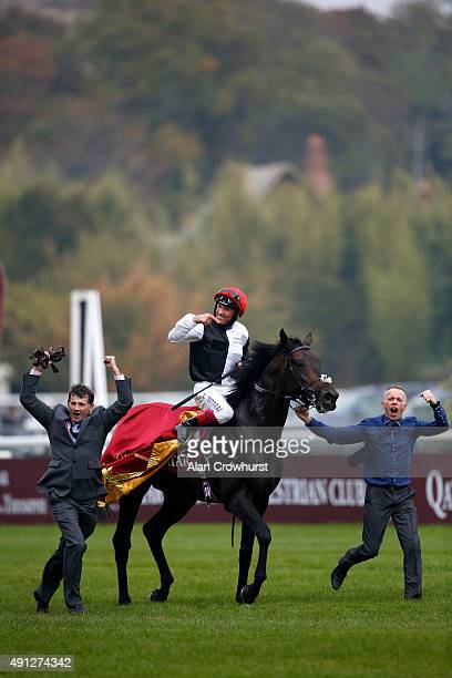 Frankie Dettori riding Golden Horn celebrate winning The Qatar Prix De L'Arc De Triomphe at Longchamp racecourse on October 04 2015 in Paris France