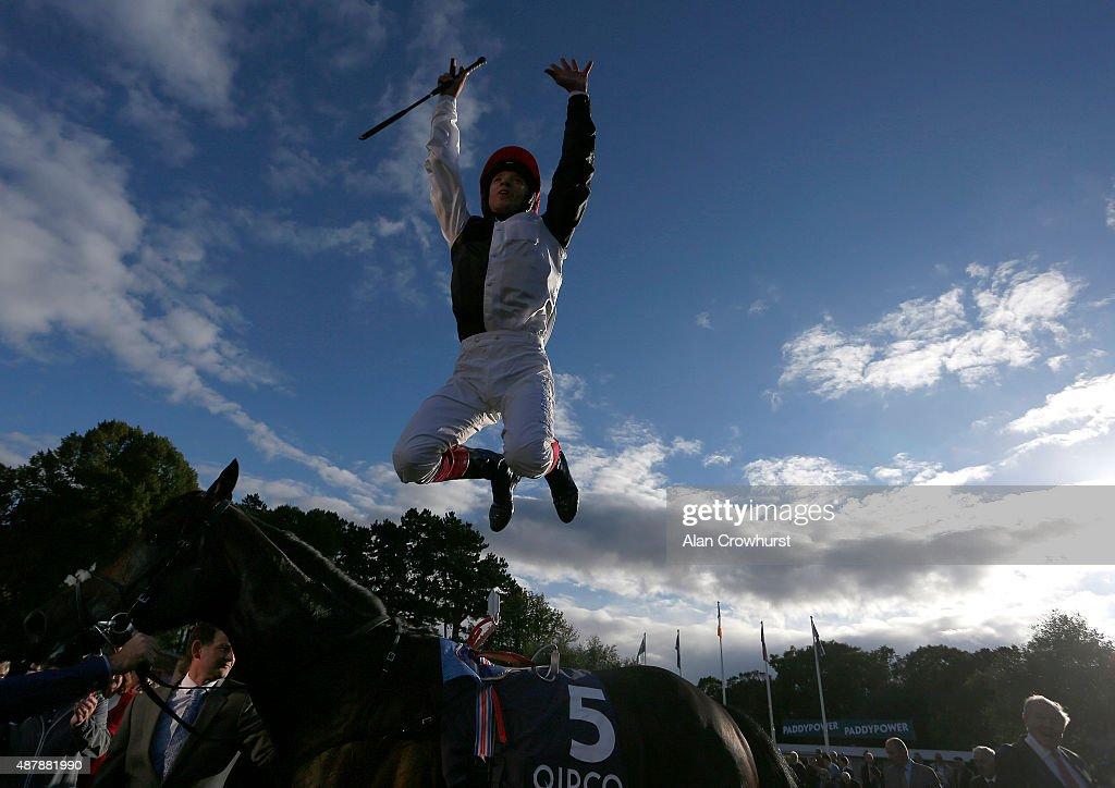 Frankie Dettori riding Golden Horn celebrate winning The Qipco Irish Champion Stakes at Leopardstown racecourse on September 12 2015 in Dublin Ireland
