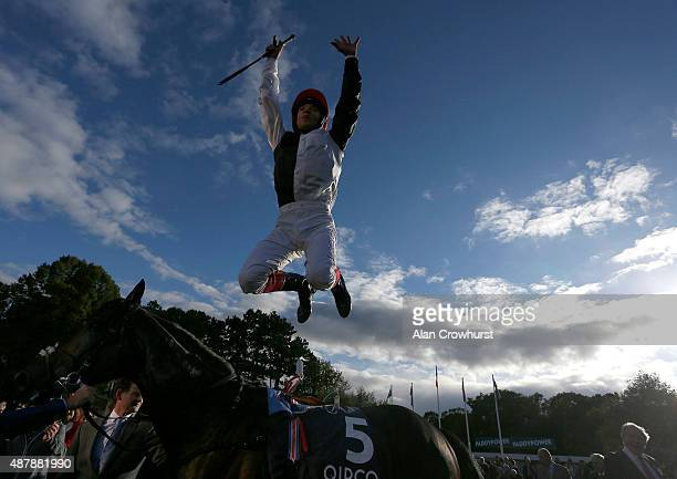 Frankie Dettori riding Golden Horn celebrate winning The Qipco Irish Champion Stakes at Leopardstown racecourse on September 12 2015 in Dublin Ireland
