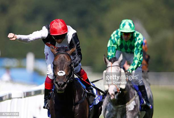 Frankie Dettori riding Golden Horn celebrates winning The Coral Eclipse at Sandown racecourse on July 04 2015 in Esher England