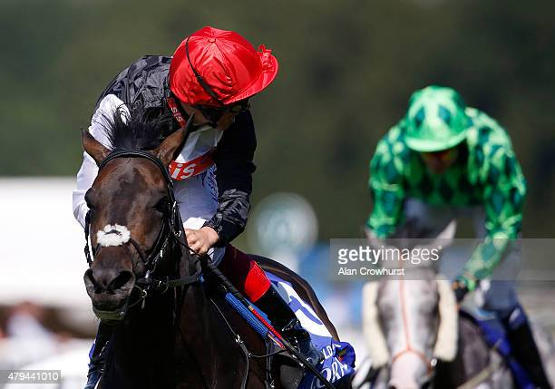 Frankie Dettori riding Golden Horn looks around for any danger to wins The Coral Eclipse at Sandown racecourse on July 04 2015 in Esher England