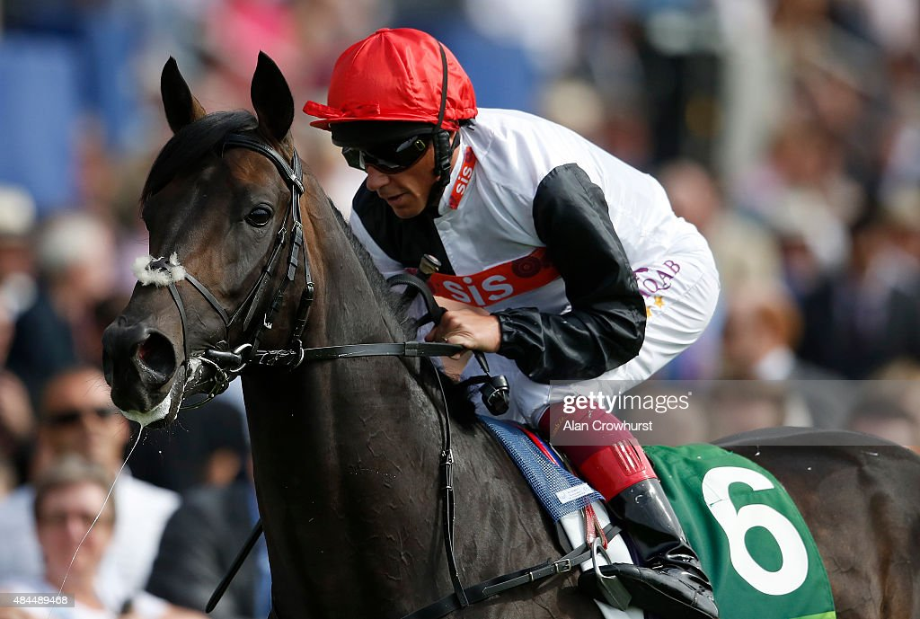 Frankie Dettori riding Golden Horn make their way to the start at York racecourse on August 19 2015 in York England