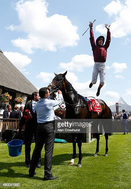 Frankie Dettori riding Mr Singh celebrate winning The Bahrain Trophy at Newmarket racecourse on July 09 2015 in Newmarket England