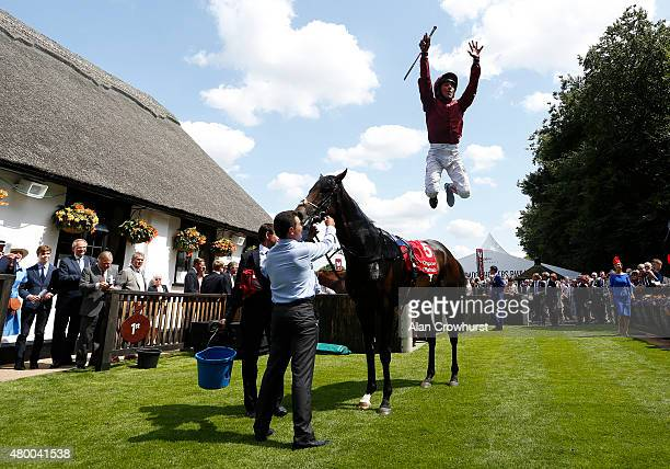 Frankie Dettori riding Mr Singh celebrates winning The Bahrain Trophy at Newmarket racecourse on July 09 2015 in Newmarket England