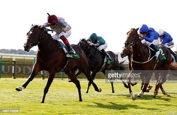 Frankie Dettori riding Shalaa win The Juddmonte Middle Park Stakes at Newmarket racecourse on September 26 2015 in Newmarket England