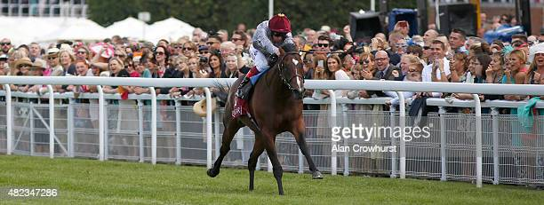 Frankie Dettori riding Shalaa win The Qatar Richmond Stakes at Goodwood racecourse on July 30 2015 in Chichester England