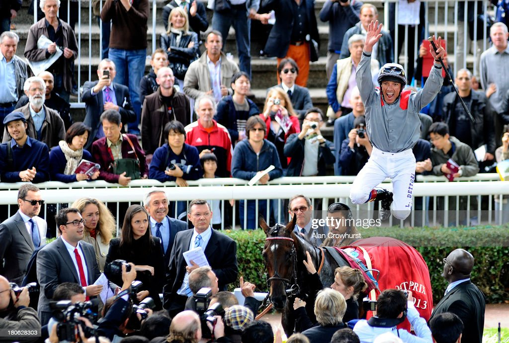 Frankie Dettori riding Treve celebrate winning The Qatar Prix Vermeille at Longchamp racecourse on September 15, 2013 in Paris, France.