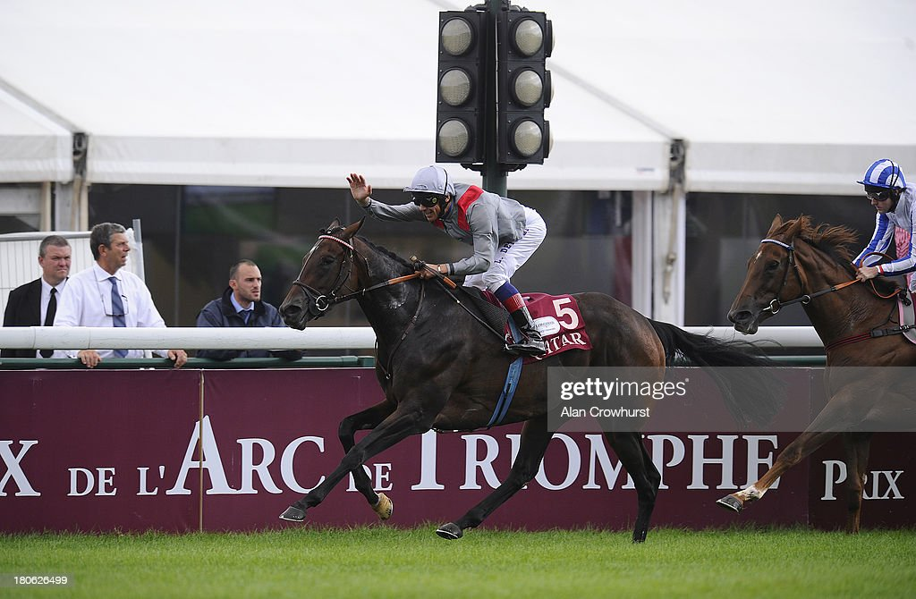 Frankie Dettori riding Treve (L) win The Qatar Prix Vermeille at Longchamp racecourse on September 15, 2013 in Paris, France.