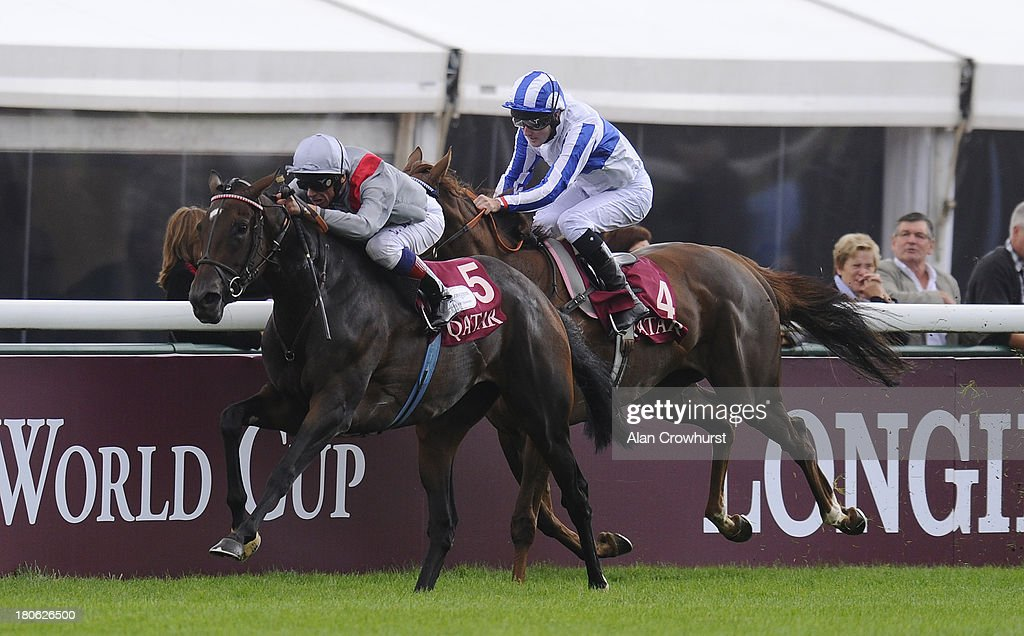 <a gi-track='captionPersonalityLinkClicked' href=/galleries/search?phrase=Frankie+Dettori&family=editorial&specificpeople=167142 ng-click='$event.stopPropagation()'>Frankie Dettori</a> riding Treve (L) win The Qatar Prix Vermeille at Longchamp racecourse on September 15, 2013 in Paris, France.